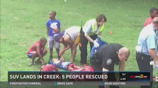 Child, 4 Others Rescued From SUV That Went Into Greensboro