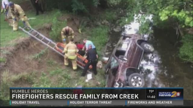 Firefighters Rescue Family From Creek