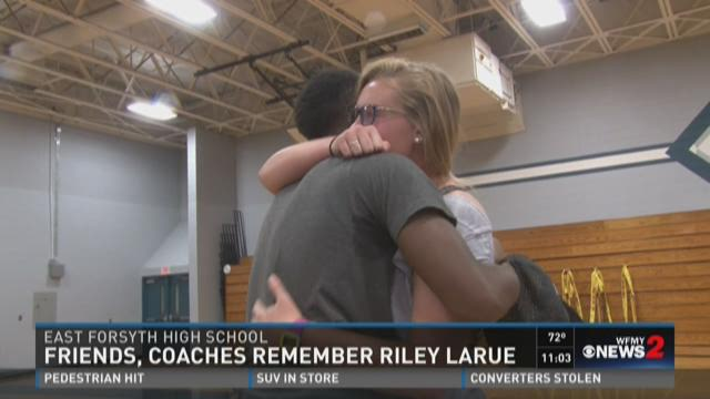 Friends, coaches, and teammates gathered Sunday to hold a moment of silence in LaRue's honor.