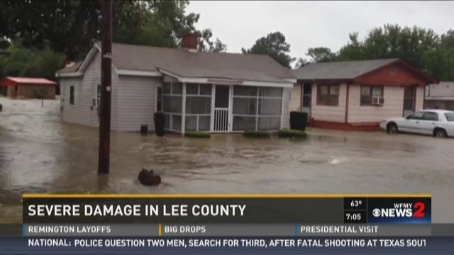 Floodwaters stand several feet high outside a home