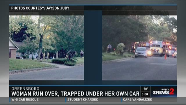 Woman trapped underneath car